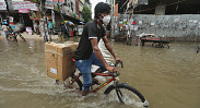 In Pictures: Waterlogging adds to dismay in city life...