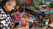 In pictures: Painting rickshaws for a living
