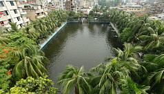 A city pond gives a glimpse of village...