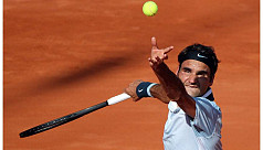 Federer makes big racquet by reaching...