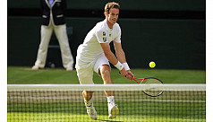 Murray fights back from the brink to...