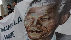 Mandela 'continues to show improvement':...