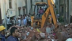 Building collapses kill 7, trap 20 in...