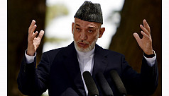 Karzai visits Pakistan, looking for...