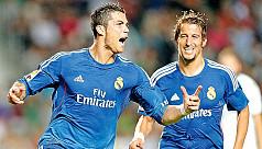 Ronaldo penalty hands Real controversial...