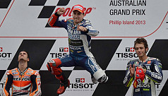 Lorenzo keeps title race alive after...