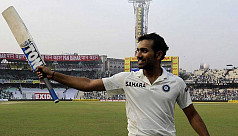 Rohit's debut century rescues India...
