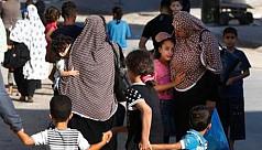 Palestinians flee after Israel warning,...
