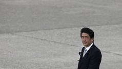 Wounded Japan PM grapples with tax jinx...
