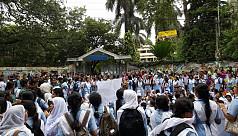Viqarunnisa students block street in...