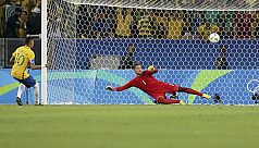Neymar hands Brazil precious football...