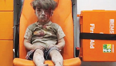 Image of Syrian boy rescued after air...