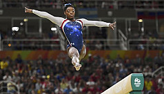 Coronation complete as Biles wins all...