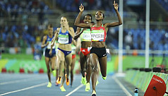 Kenyan Kipyegon in late charge for 1,500m...