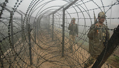India fences half of its border with...