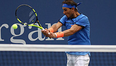 Nadal vows to keep working, resets goals...