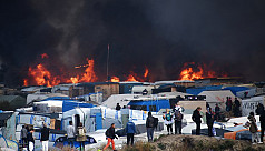 'Jungle' migrant camp ablaze as demolition...