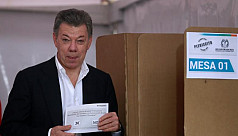 Colombia's President Santos tries to...