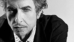 Bob Dylan removes Nobel mention from...