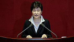 South Korean presidential aides raided...