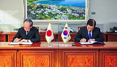South Korea, Japan sign military intelligence...