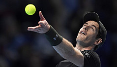 Murray wobbles but hangs on to beat...