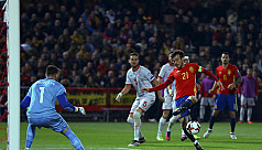 Spain, Italy cruise as Wales held again...