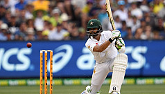 Australia hold edge after rain dampens...