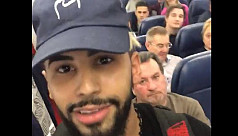 Passengers removed from plane 'for speaking...