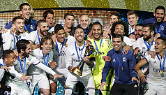 Real Madrid survive scare to win club...