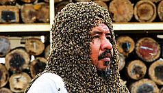 Saudi man aims to break bee bearding world record