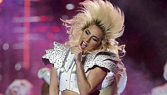 Lady Gaga soars over Super Bowl stage...