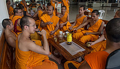 Unholy row: Thai monks and cops in bizarre temple turf war