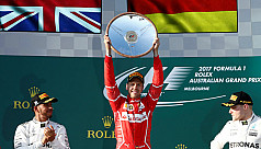 Vettel savours win as Ferrari strike...
