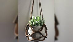 Knotted string hanging planter from recycled materials