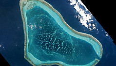 China to build on disputed shoal in...
