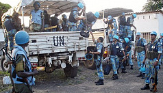 UN votes on more peacekeepers, less...