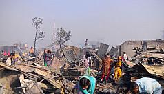 Fire-affected Korail slum dwellers in...