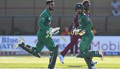 Malik ton as Pakistan down West Indies...