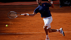 Wawrinka falls in Rome, Djokovic into...