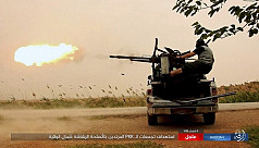 IS attack kills 32 at Syria refugee...