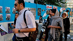 Iran election: Voters go to the polls...