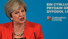 British PM May amends key campaign...