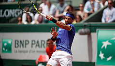 Nadal, Djokovic into quarters as champion...