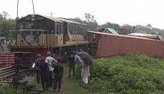 Two suspended over freight train derailment...