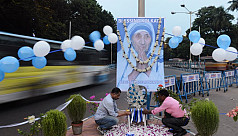 Mother Teresa's famous blue-rimmed white cotton sari trademarked