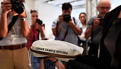 Neil Armstrong's moon bag sells for $1.8m