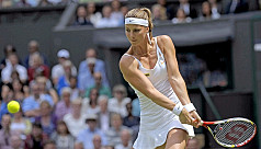 Mandy Minella competes in Wimbledon...