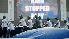 India stretch lead to 365 before rain...
