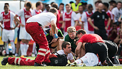 Ajax midfielder Nouri stable after collapsing...